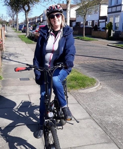 Jane on her bike in the sunshine