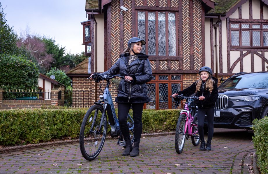Mum and daughter with bikes and car